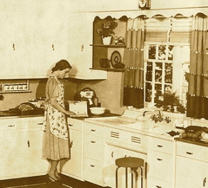 Woman in 1930's kitchen