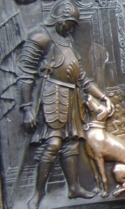 The dog on the statue on the Charles Bridge in Prague - every passerby rubs the dog for good luck.