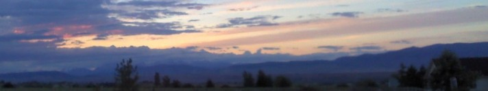 Wind blowing clouds across a Kittitas Valley sunset.