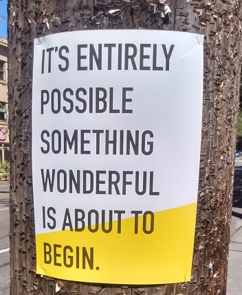 "Sign says ""it's entirely possible something wonderful is about to begin."""